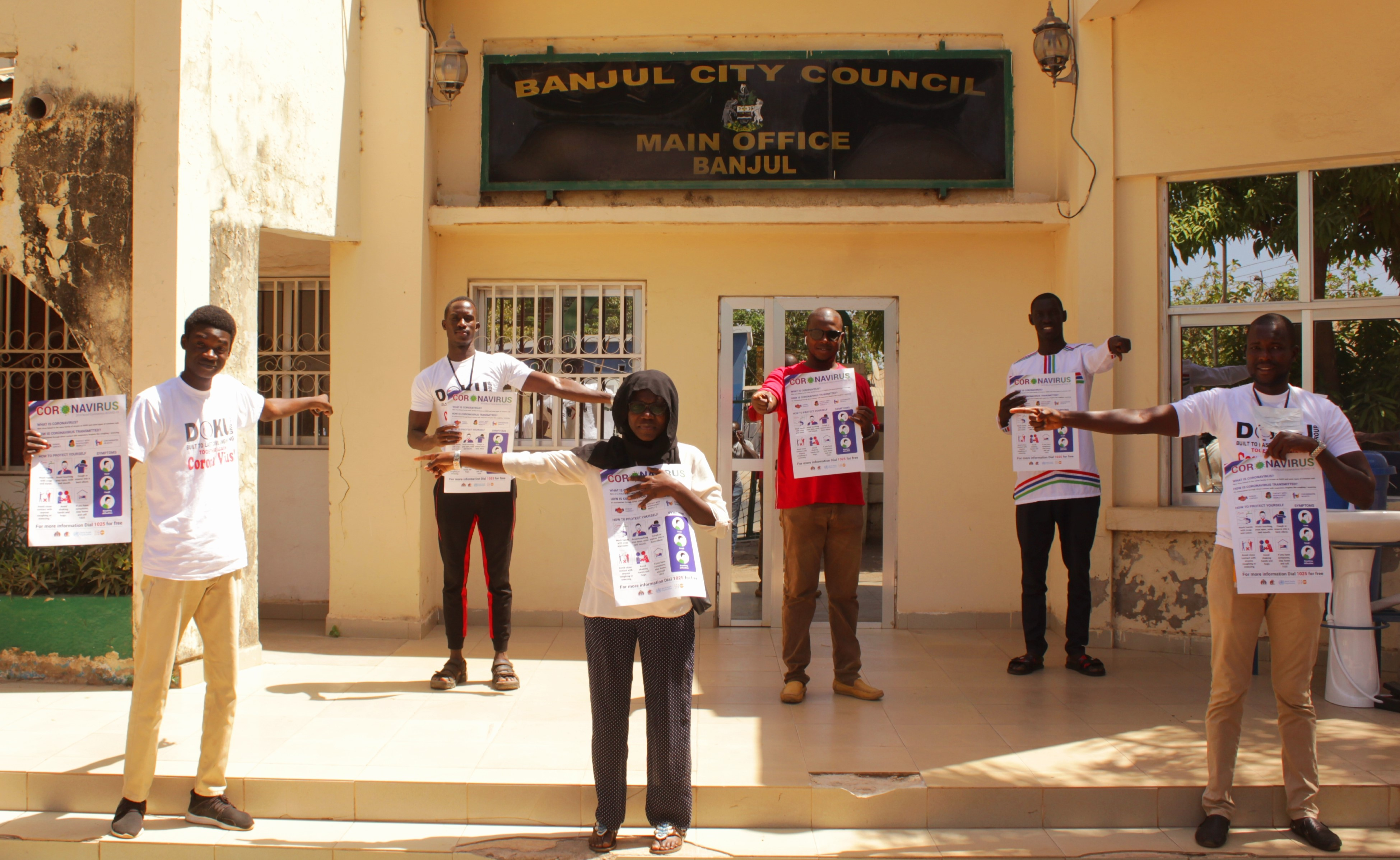 Young people of Banjul demonstrating social distancing at the Banjul City Council grounds