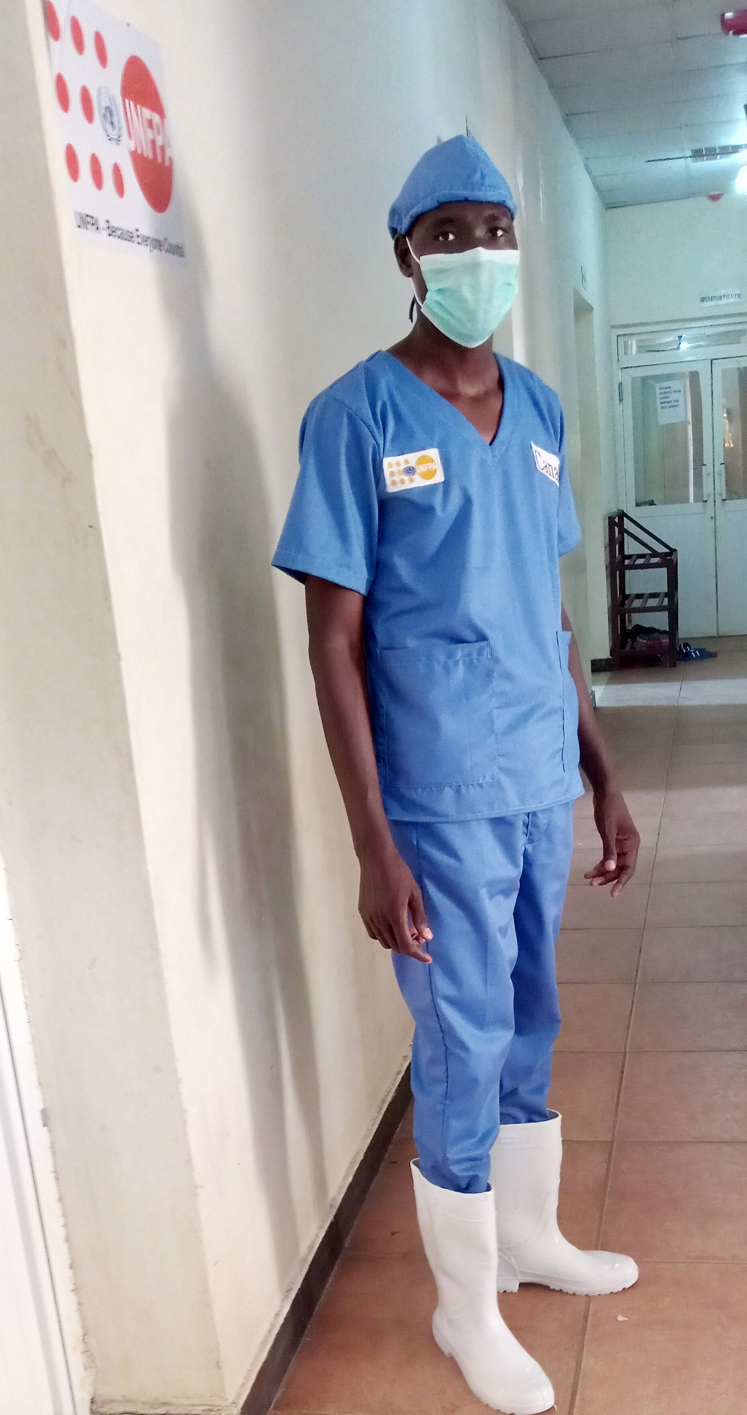 Mr. Mangwi suited up for the delivery room at Torit State Hospital.